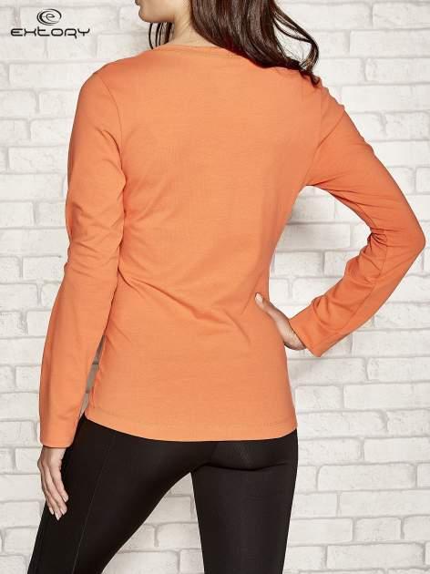 Pomarańczowa bluzka sportowa z dekoltem U                                  zdj.                                  3