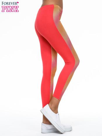 Pomarańczowe legginsy we fluorescencyjne wzory                                  zdj.                                  3