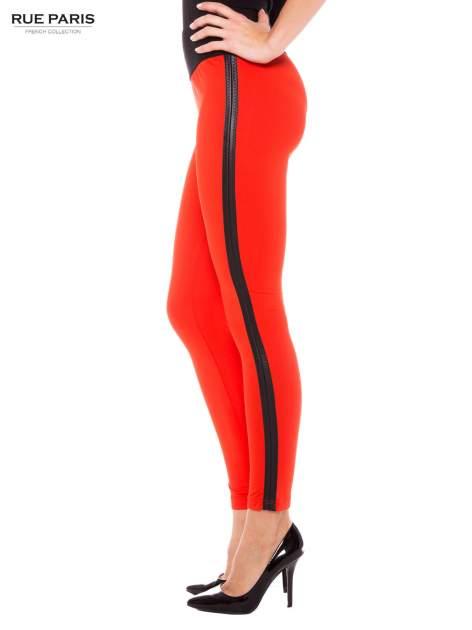 Pomarańczowe legginsy ze skórzanymi lampasami po bokach                                  zdj.                                  2