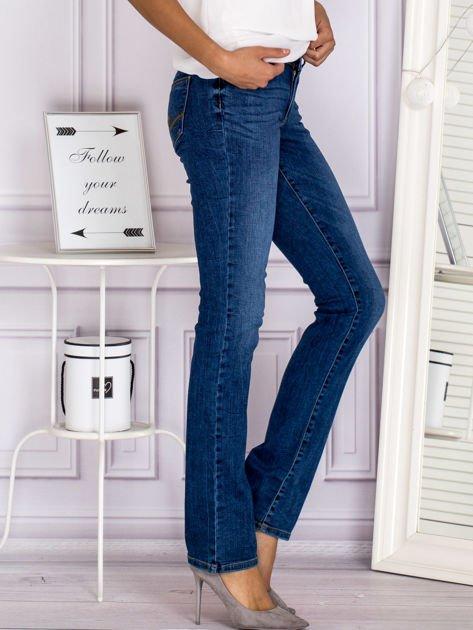 Proste spodnie jeansowe z delikatnymi przetarciami niebieskie                                  zdj.                                  3