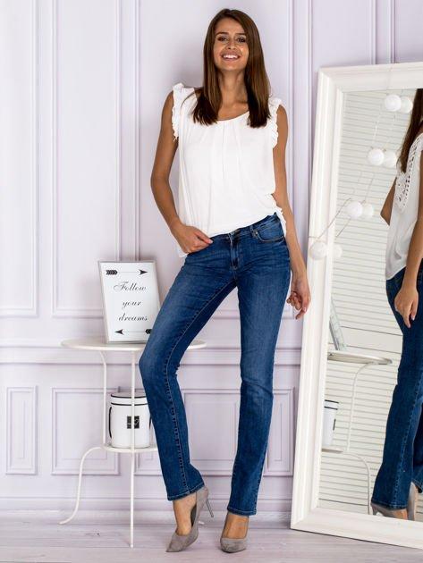 Proste spodnie jeansowe z delikatnymi przetarciami niebieskie                                  zdj.                                  4