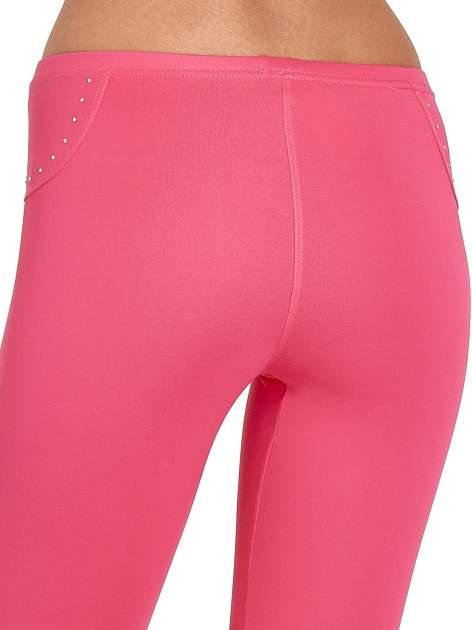 Różowe legginsy sportowe termalne z dżetami i ściągaczem                                  zdj.                                  4