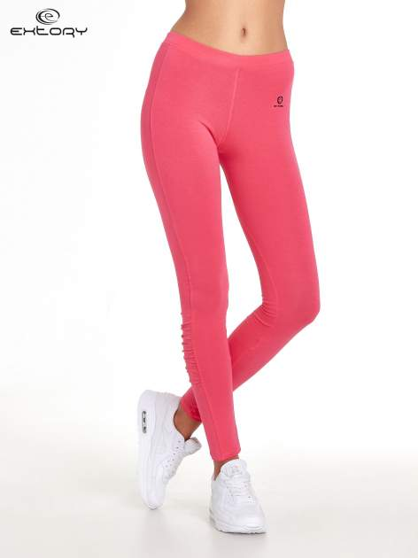 Różowe legginsy sportowe z drapowaniem