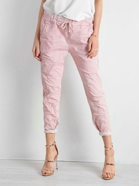 Różowe spodnie damskie z lampasami                              zdj.                              1