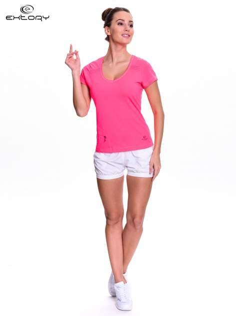 Różowy t-shirt sportowy z kieszonką na suwak PLUS SIZE                                  zdj.                                  2