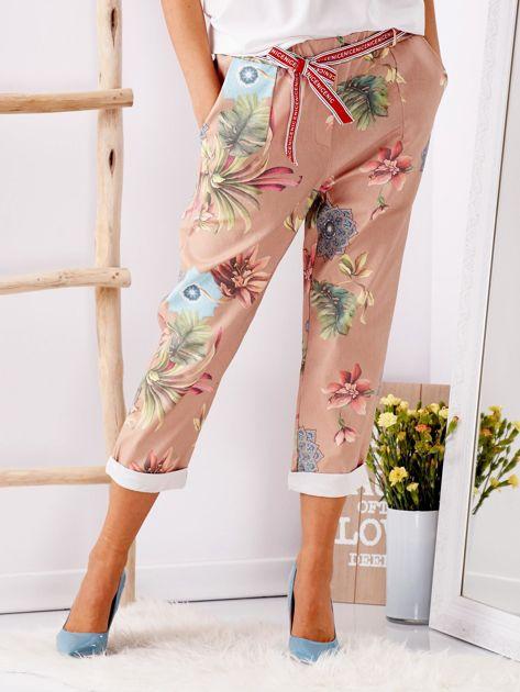 Beżowe spodnie w kwiaty                              zdj.                              4