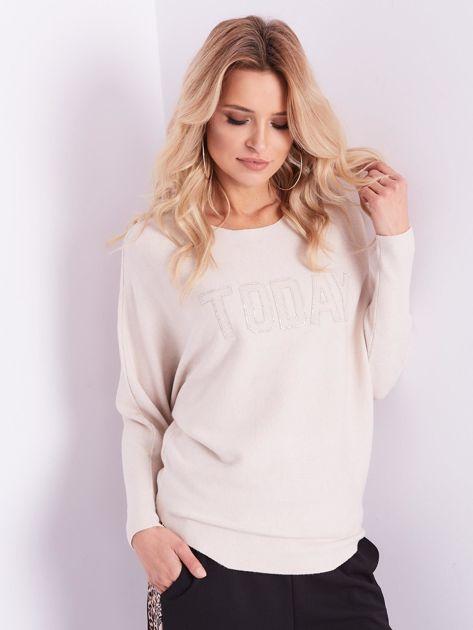 SCANDEZZA Beżowy sweter oversize z błyszczącym napisem                              zdj.                              13