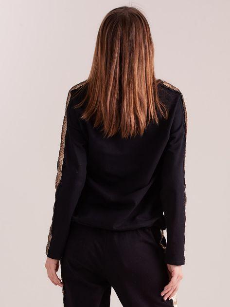 SCANDEZZA Czarna bluza ze złotymi cekinami                              zdj.                              3