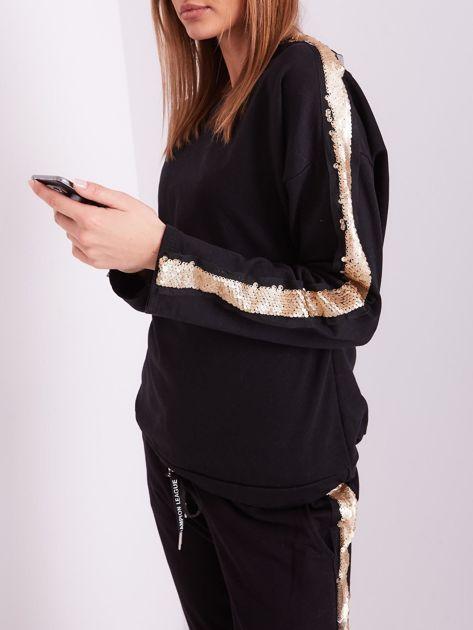 SCANDEZZA Czarna bluza ze złotymi cekinami                              zdj.                              7