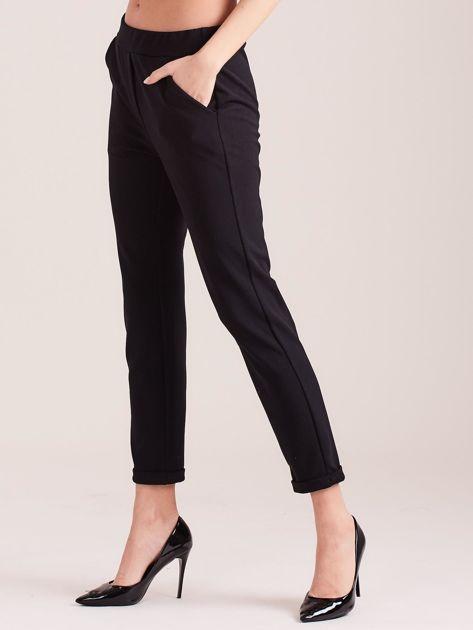 SCANDEZZA Czarne damskie spodnie                              zdj.                              4