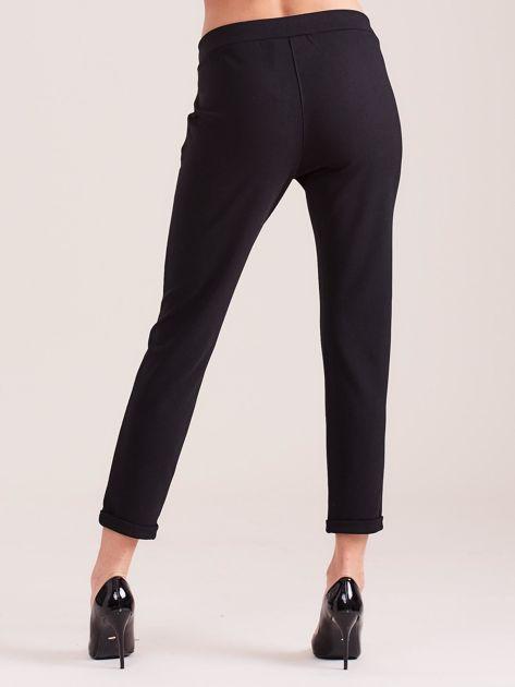 SCANDEZZA Czarne damskie spodnie                              zdj.                              5