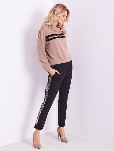 Czarne spodnie z motywem zwierzęcym                              zdj.                              12