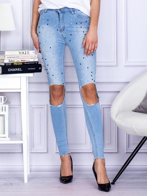 Spodnie jeansowe z dziurami i perełkami niebieskie                              zdj.                              1