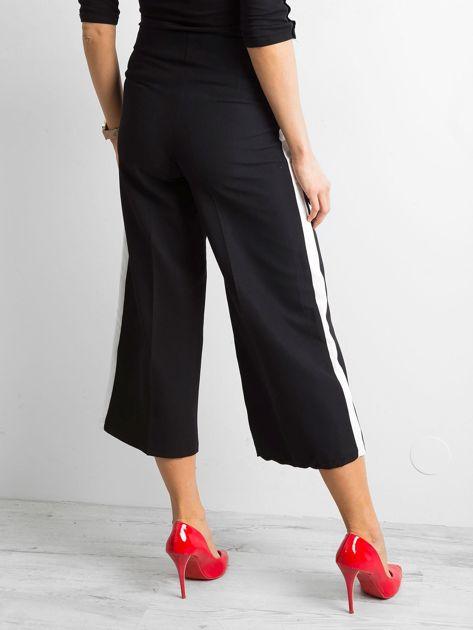 Szerokie spodnie z lampasami czarne                              zdj.                              2