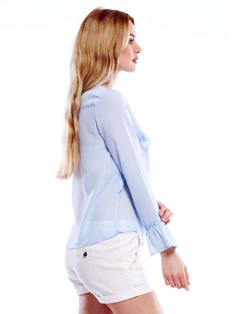 Szyfonowa bluzka z falbankami i aplikacją jasnoniebieska                              zdj.                              7