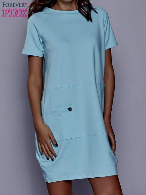 Turkusowa sukienka dresowa z kieszenią z boku                                  zdj.                                  1