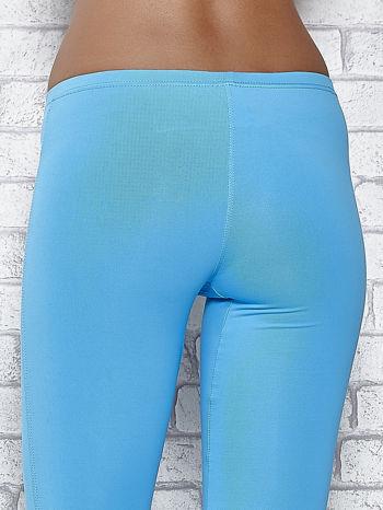 Turkusowe legginsy sportowe termalne z dżetami na nogawkach                                  zdj.                                  5