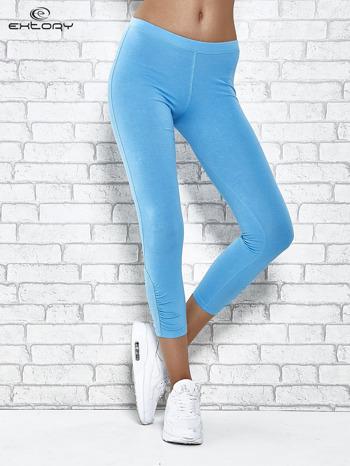 Turkusowe legginsy sportowe z aplikacją z dżetów na nogawkach                                  zdj.                                  1
