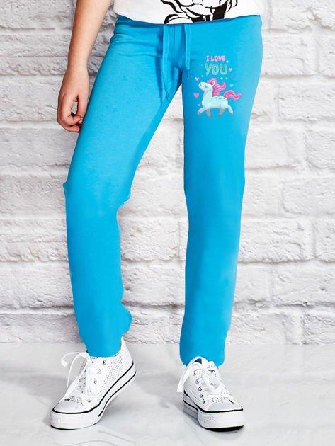 Turkusowe spodnie dresowe dla dziewczynki z kolorowym jednorożcem                                  zdj.                                  1