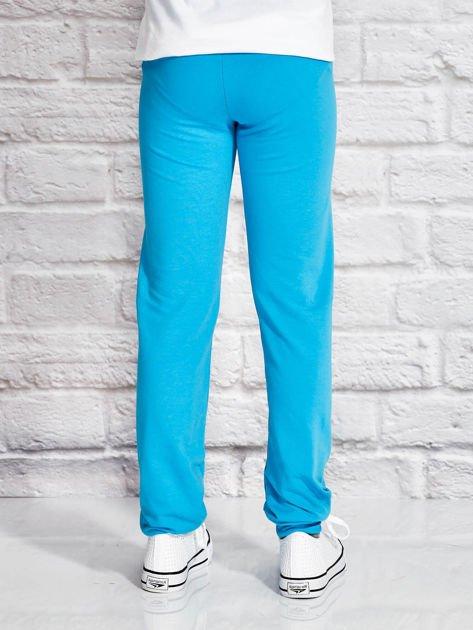 Turkusowe spodnie dresowe dla dziewczynki z kolorowym jednorożcem                              zdj.                              2