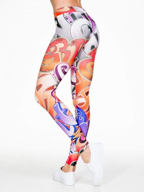 Wielokolorowe legginsy w abstrakcyjny wzór                                  zdj.                                  7