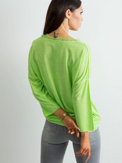 Zielona bluzka z delikatnym połyskiem                              zdj.                              2