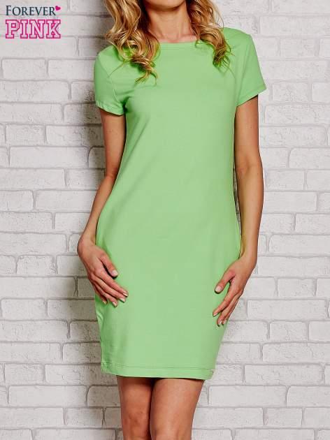 Zielona sukienka dresowa z kieszeniami