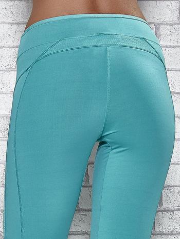 Zielone legginsy 3/4 sportowe termalne z lampasami                                  zdj.                                  6