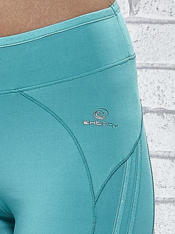 Zielone legginsy 3/4 sportowe termalne z lampasami                                  zdj.                                  7