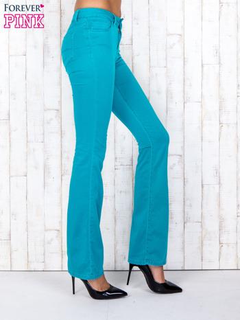 Zielone materiałowe spodnie dzwony                                  zdj.                                  3