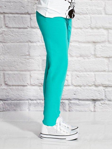 Zielone spodnie dresowe dla dziewczynki SUPER GIRL                                  zdj.                                  3