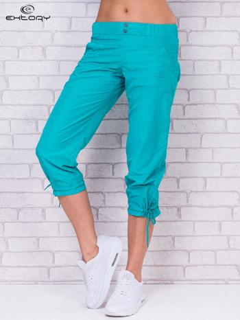 Zielone spodnie sportowe capri z guzikami