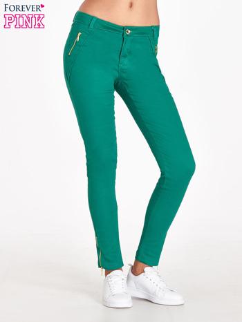 Zielone spodnie ze złotymi suwakami                                  zdj.                                  1