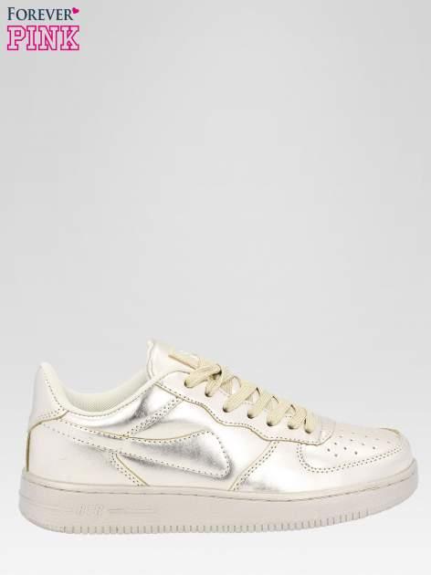 Złote buty sportowe na grubej podeszwie