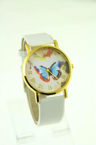 Złoty zegarek damski na białym pasku                                  zdj.                                  1