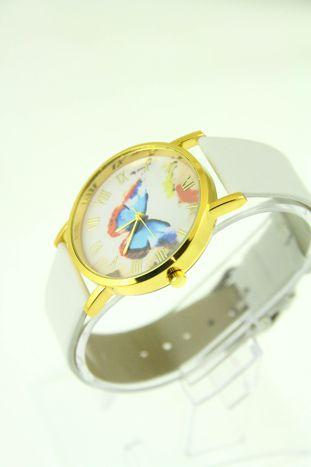 Złoty zegarek damski na białym pasku                                  zdj.                                  2