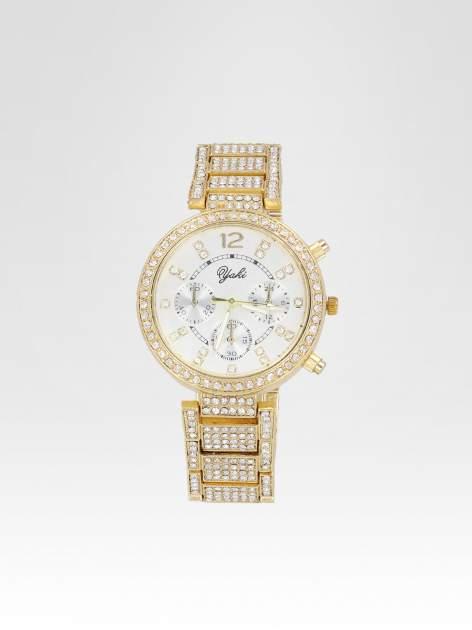 Złoty zegarek damski na bransolecie zdobiny cyrkoniami