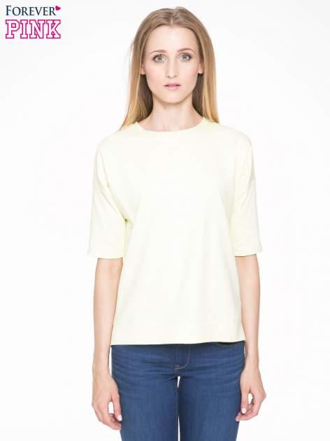 Żółta bluza z suwakiem z tyłu