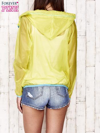 Żółta kurtka wiatrówka z niebieskim suwakiem                                  zdj.                                  2