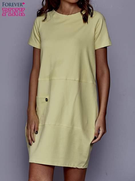 Żółta sukienka dresowa z kieszenią z boku