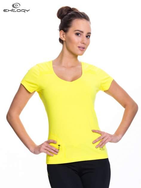 Żółty t-shirt sportowy z kieszonką na suwak PLUS SIZE