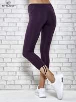 Ciemnofioletowe spodnie capri z surowym wykończeniem PLUS SIZE