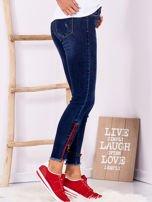 Ciemnoniebieskie jeansowe spodnie z suwakami                                  zdj.                                  3