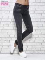 Ciemnoniebieskie skinny jeans z przeszyciami i suwakami                                  zdj.                                  1