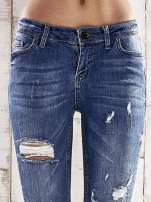 Ciemnoniebieskie spodnie skinny jeans z dziurami                                                                          zdj.                                                                         4