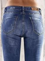 Ciemnoniebieskie spodnie skinny jeans z dziurami                                                                          zdj.                                                                         6