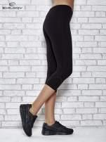 Czarne legginsy sportowe z dżetami i marszczoną nogawką za kolano                                  zdj.                                  2