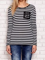 Czarno-biała bluzka w paski z cekinowymi motywami                                  zdj.                                  1