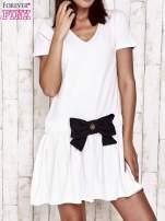 Miętowa sukienka dresowa z kokardą z przodu
