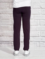 Grafitowe spodnie dresowe dla dziewczynki z emotikonami                                  zdj.                                  2